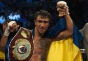 Vasyl Lomachenko of Ukraine celebrates after his victory over Chonlatarn Piriyapinyo of Thailand (not pictured) in their WBO featherweight title boxing bout at the Cotai Arena in Macau on November 23, 2014.       AFP PHOTO / XAUME OLLEROSXAUME OLLEROS/AFP/Getty Images